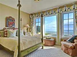 This beachfront bedroom overlooks the outdoor jacuzzi.