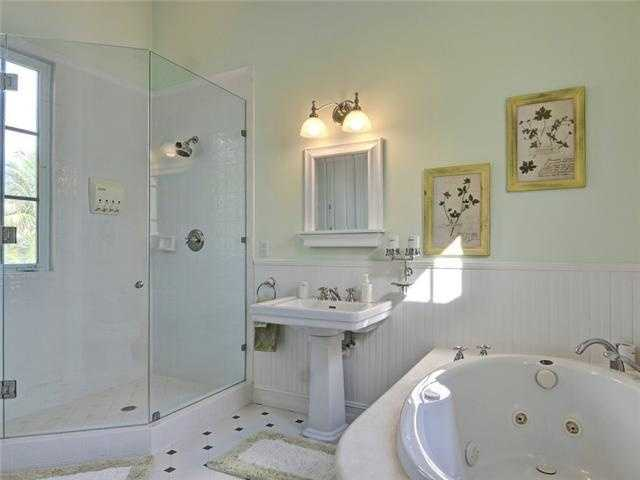 Master bathroom has a beautiful spa tub and glass shower unit.