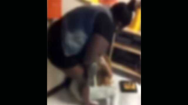 Two high school girls in Boynton Beach were seen on videotape fighting in a classroom.