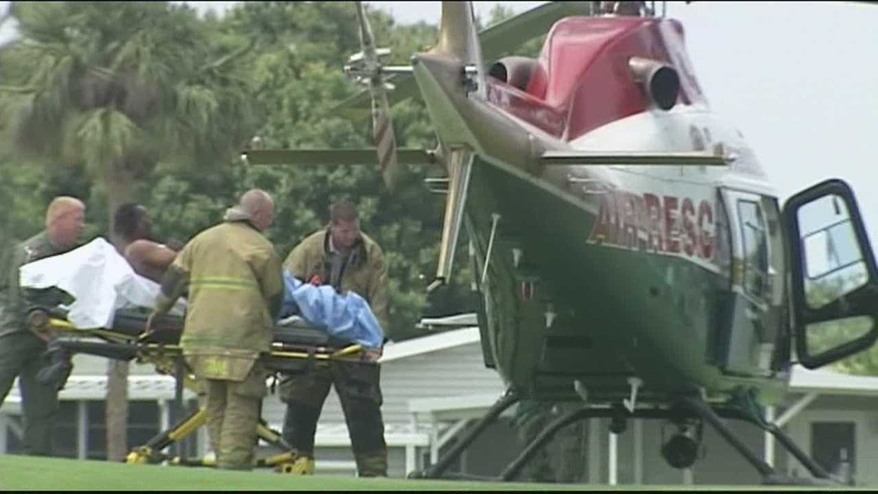 A handyman is loaded onto a medical helicopter after being burned in a fire.