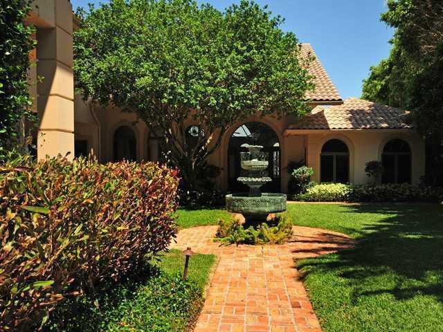 Courtyard has romantic landscaped influences.