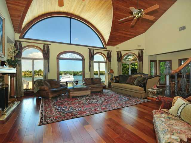 Large arch windows in the living room to showcase the waterfront views and natural light.