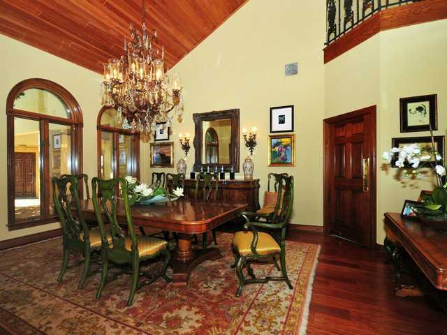 Formal dining room looks out to the courtyard.