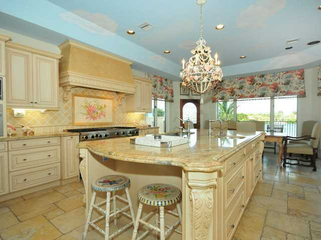 Adorable sky painted on the ceilings of the kitchen, gas stove, and huge kitchen island.