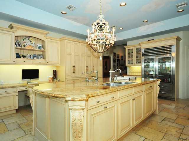 Modern appliances seen throughout this luxurious kitchen.