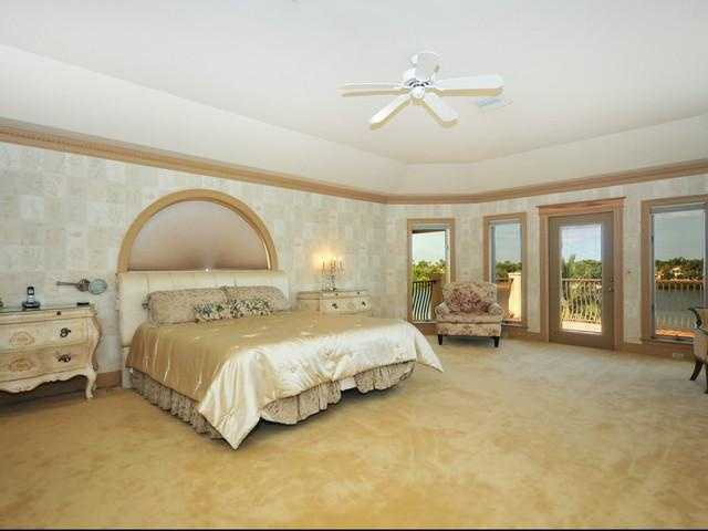 Master bedroom is a spacious romantic space with a private balcony, measuring at 25 ft. and 18 ft.