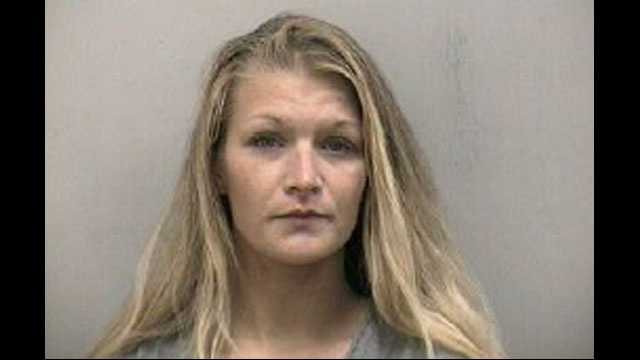 Heather Scherrer was arrested in connection with a robbery in the parking lot of a Walgreens in Stuart.