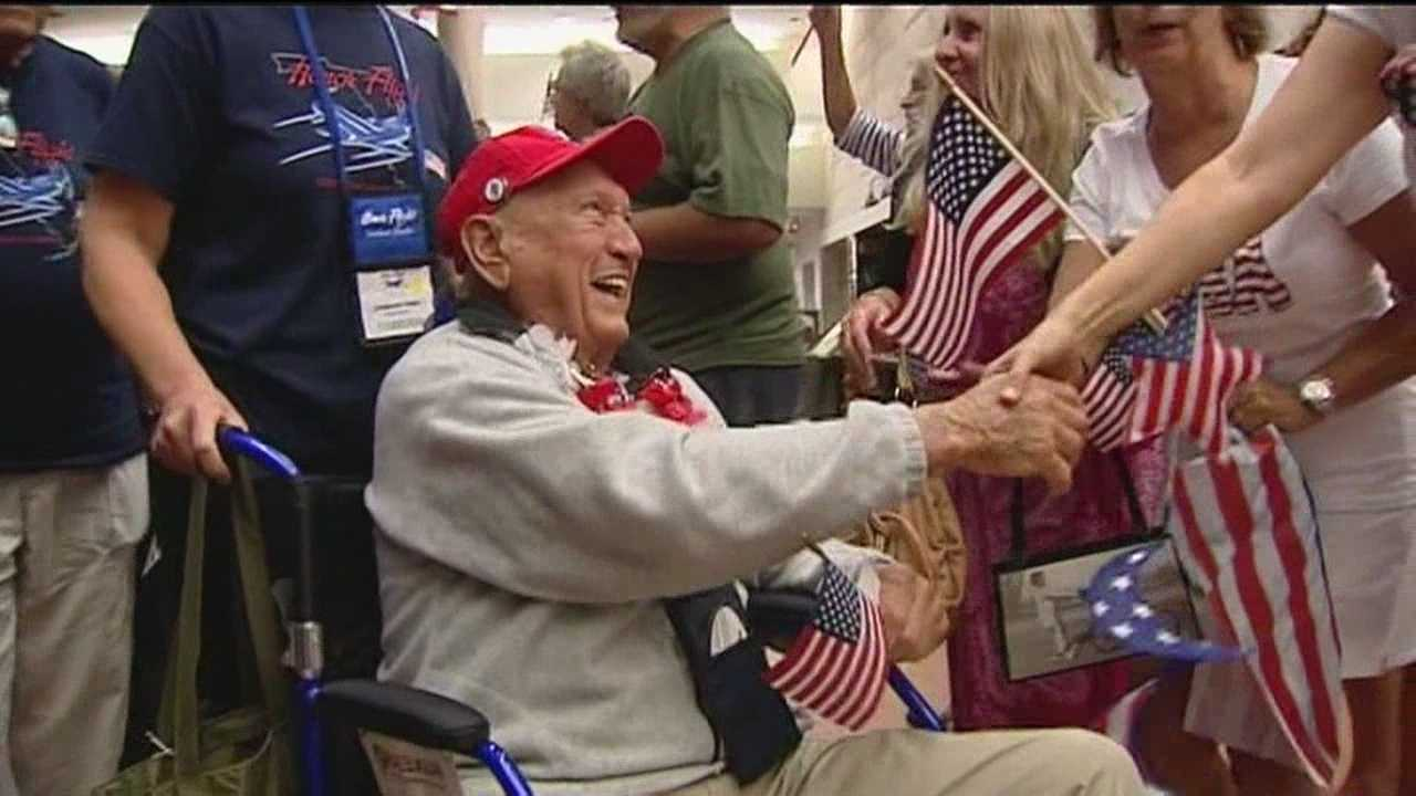 Some local World War II veterans got the red-carpet treatment upon arriving back from Washington, D.C., at Palm Beach International Airport on Saturday.