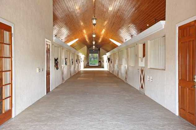 Not only are there 18 horse stalls, but the whole barn is kept immaculate.