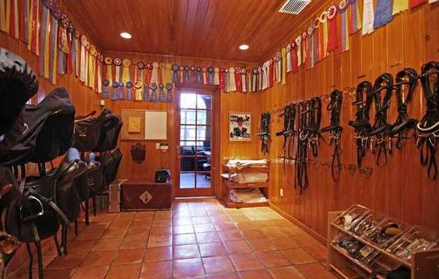 Awards cover the walls of this saddle room.