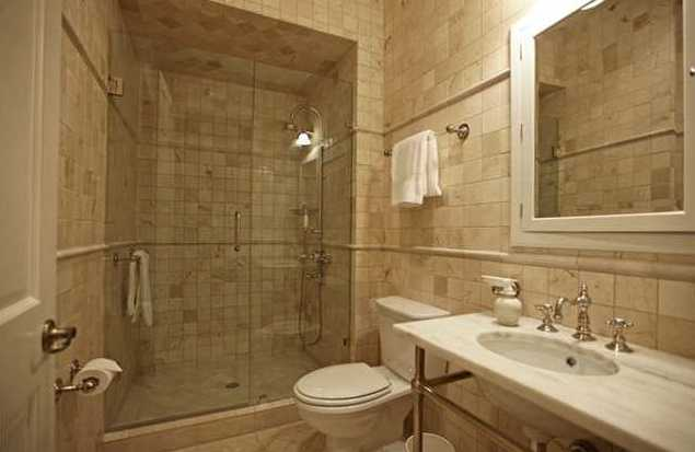 Master bathroom is tiled masterfully and features a large walk-in shower.
