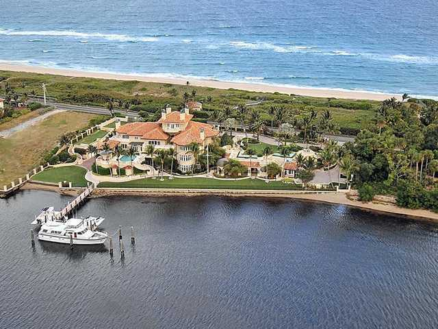 This aerial view shows the home's private dock and proximity to the ocean.