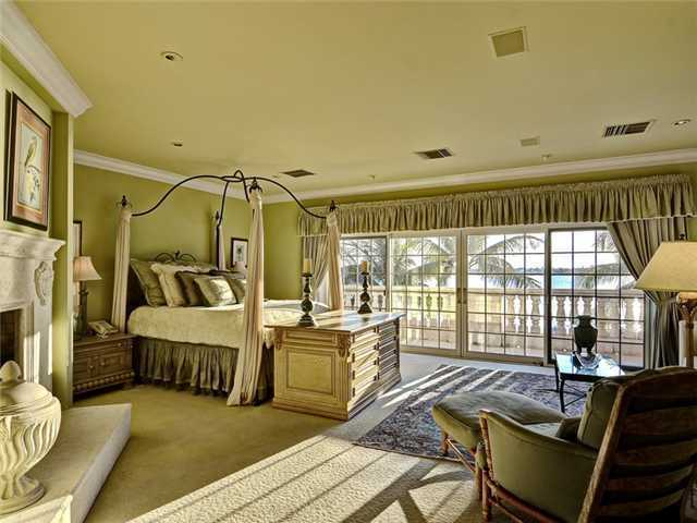 Master bedroom features a full-length balcony.