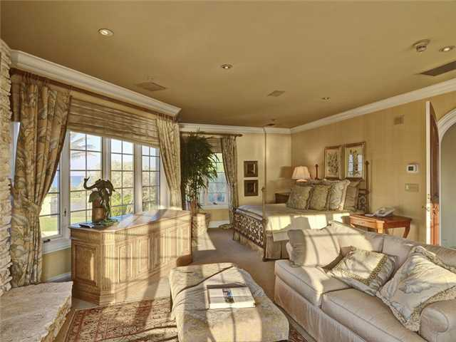 Enjoy the panoramic views throughout this bedroom, as you lounge in bed or in the sitting area.