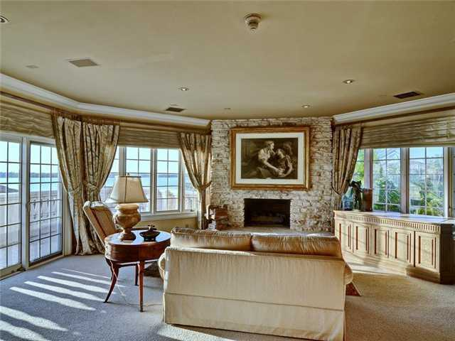 Relax in front of the fireplace as you look out onto the oceanview.