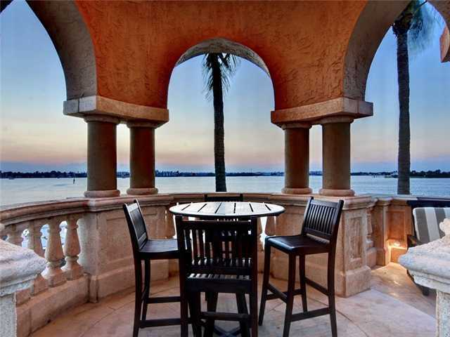 At the edge of the patio is a secluded dining space for four.