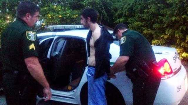 This burglary suspect is taken into custody.