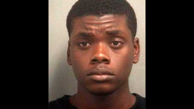 Avery Wilson is accused in an armed robbery that left a woman shaken and an officer injured.