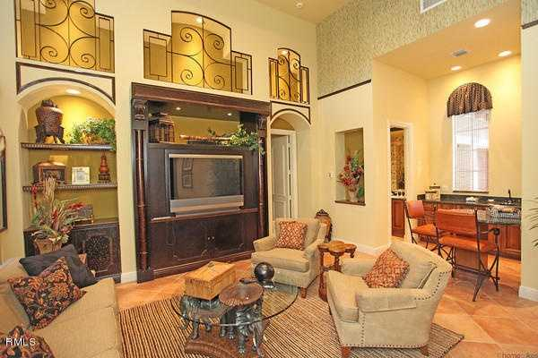 Built-in shelves and custom entertainment unit in this large family room, which also has vaulted ceilings.