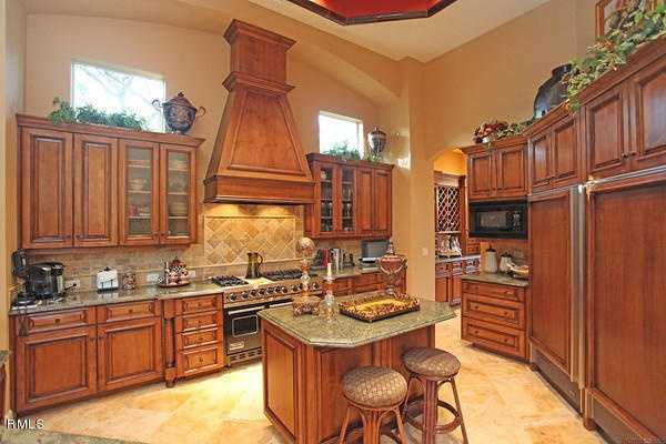 Beautiful summer kitchen, with impressive appliances and cabinetry.