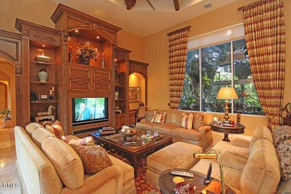 A second family room, featuring an equally beautiful custom entertainment unit.