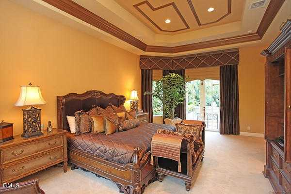 Master bedroom also features custom molded, vaulted ceilings.