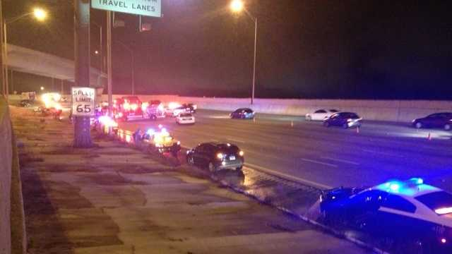 Officials with the Florida Highway Patrol say a car crashed into a patrol car and two other vehicles Sunday night on northbound I-95 near Belvedere Road.