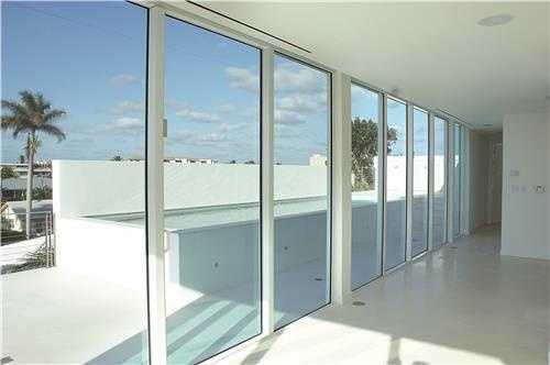 A private elevator and luxurious private lap pool, placed atop a dramatic roof-top terrace.