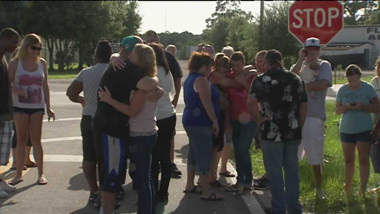 A day after a man shot and killed two people and injured a third before turning the gun on himself, friends and loved ones gathered at a vigil to mourn in Fort Pierce.