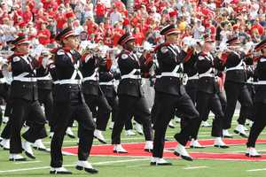 """The Ohio State University Marching Band first performed its signature formation in 1936, writing out """"Ohio"""" with marching band members and creating a special place of honor for the member dotting the """"i."""""""