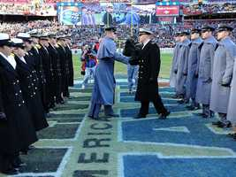 The Army vs. Navy March is a pregame tradition of the longstanding rivalry between the service academies. The Army Corps of Cadets and the Brigade of Midshipmen march onto the field before kickoff and exchange pleasantries at midfield.