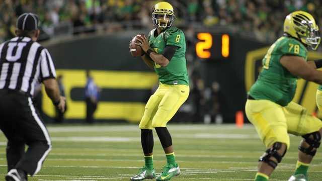 As a redshirt freshman last season, Oregon quarterback Marcus Mariota threw for 2,677 yards and 32 touchdowns against just six interceptions. He also ran for 752 yards and five touchdowns.