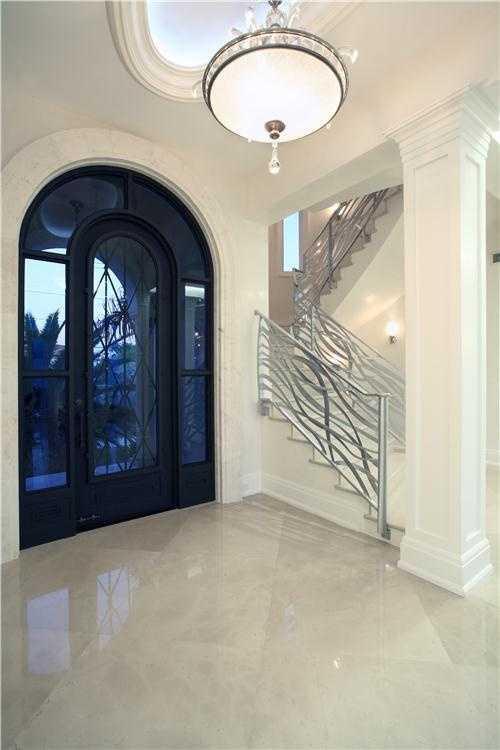 Immediately, the designers take your breath away with a sleek modern foyer.