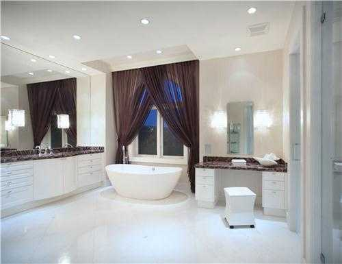 You'll enjoy retreating to this master bathroom each time you step into this free-standing Roman tub. By the way, this is one of 17 bathrooms on the property.