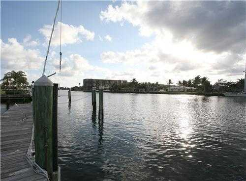 Multi-boat dockage is featured on the 100+/--foot Intracoastal shoreline, where a private wooded mangrove preserve backdrops the separate guest house.