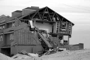 2004: Hurricane Ivan claimed 25 lives as a category 3 storm. This home was damaged in Navarre Beach.