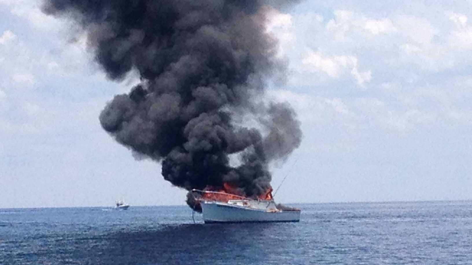 This boat caught fire and sank Sunday afternoon.