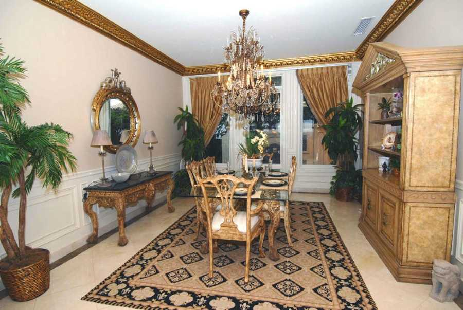 Regal accents throughout the formal dining room make this room perfect for entertaining.
