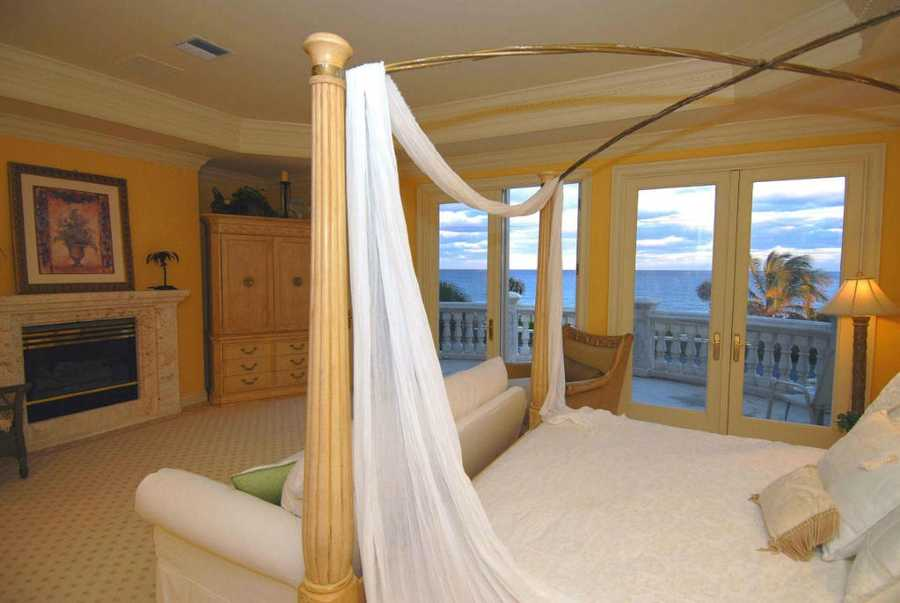 Master bedroom has a spacious balcony overlooking a spectacular ocean view.