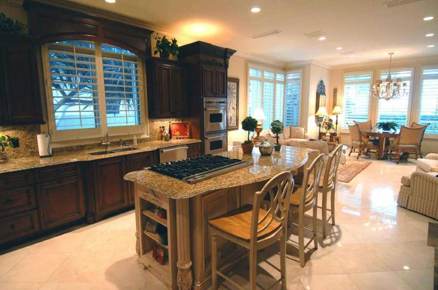 Newly remodeled kitchen features granite counter-tops.