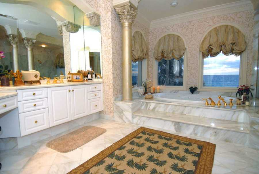 Master bathroom allows you to soak in spa tub while overlooking the ocean as well.