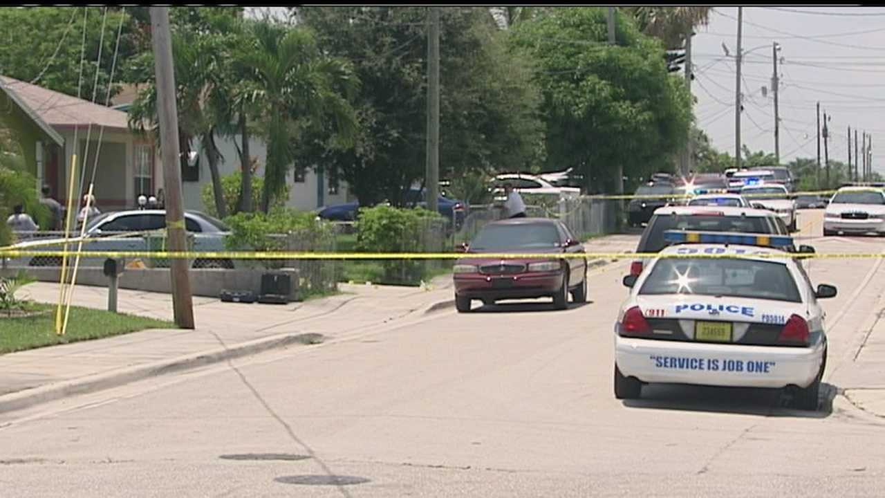 A woman explains how she dropped to the floor and started to pray after someone opened fire at her Riviera Beach home.