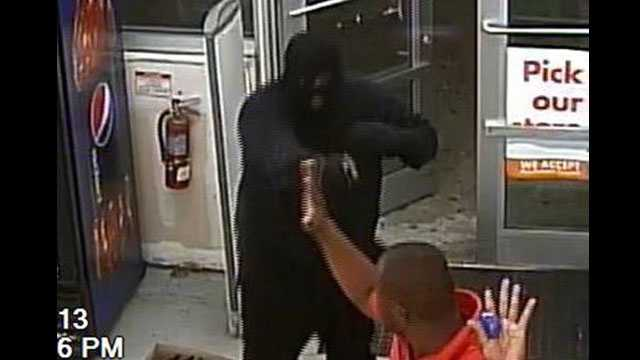 Detectives are trying to identify two masked gunmen who robbed the Family Dollar store in Pahokee.
