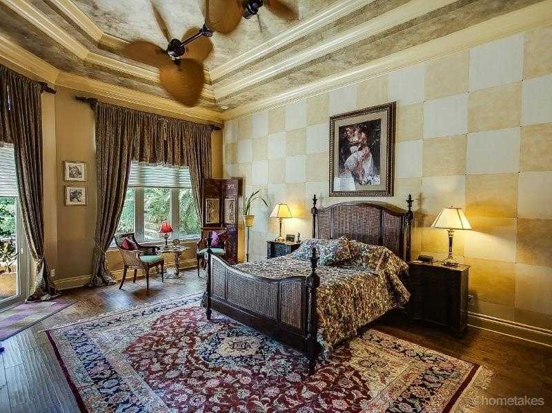 Master bedroom features an elegant Tuscan design, vaulted ceilings and spectacular views.