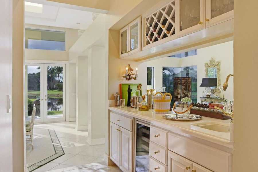 Wine cabinets and cooler are also in the kitchen.