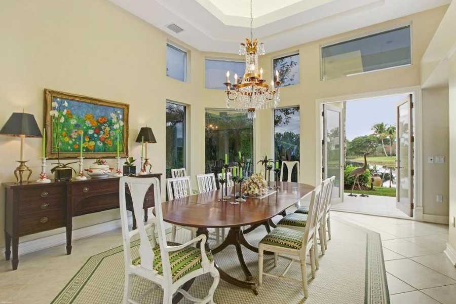 Open the patio doors on a beautiful day so you can dine by the lake in the formal dining room.