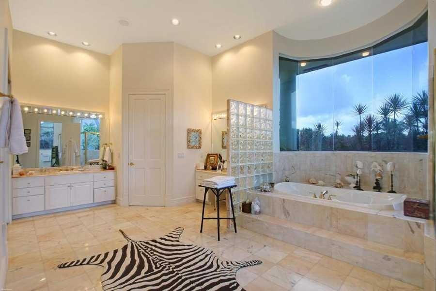 Master bathroom features a spa tub and incredible views.