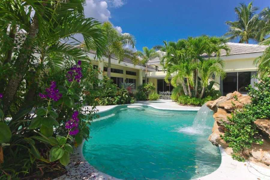 Huge pool with a beautiful waterfall.
