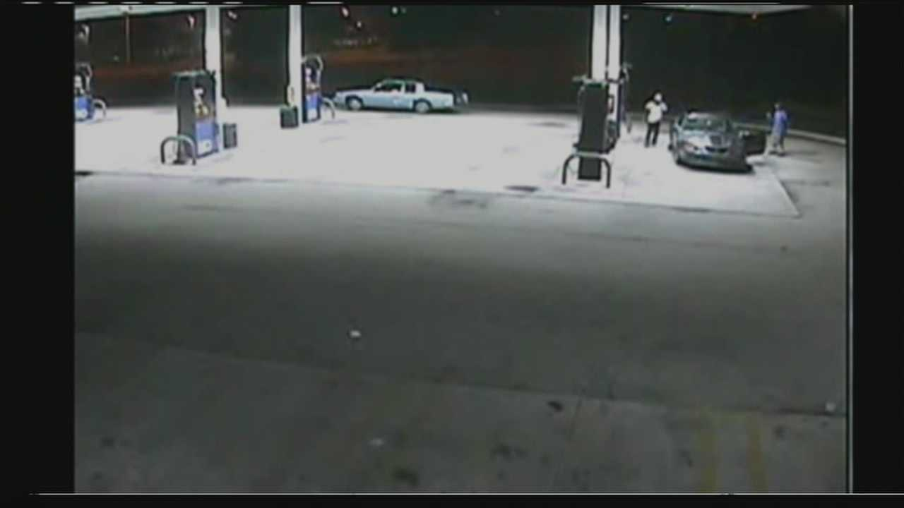 Surveillance video shows two armed men carjacking a driver at a Boynton Beach gas station.