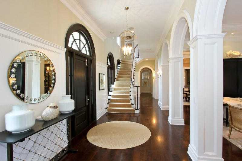 The elegant foyer sets the tone for the home's timeless interior design.